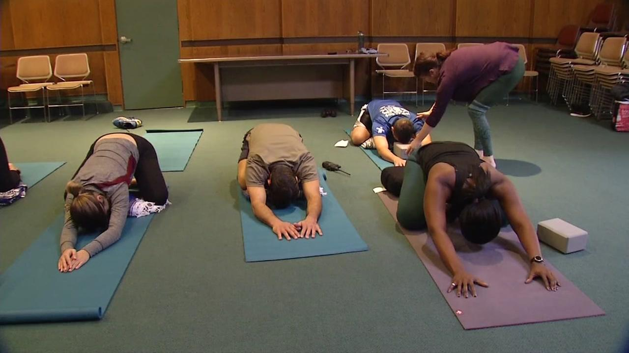 Police officers do yoga in the East Bay in this undated image.