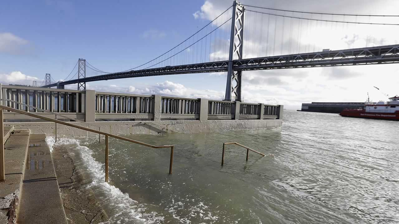 Water from a king tide floods a staircase along the Embarcadero in San Francisco in this undated file photo.