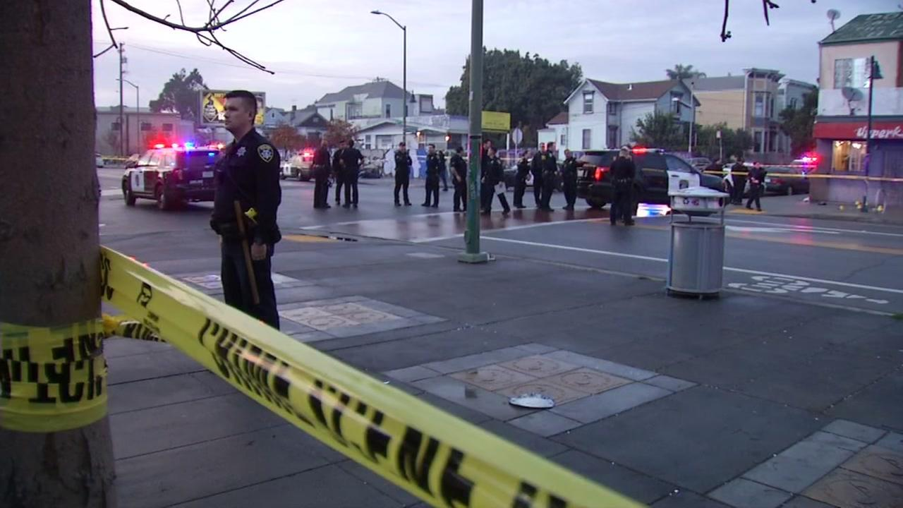 This is an image of police at the scene of an officer-involved shooting near the West Oakland BART station on Wednesday, January 3, 2018.