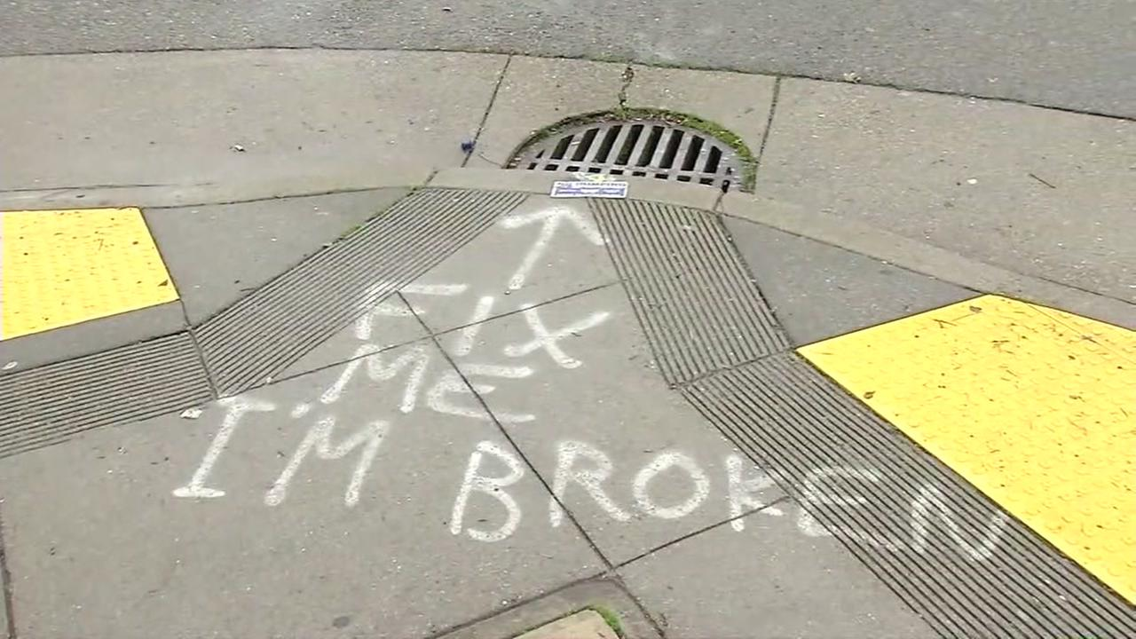 This is an image of spray paint reading Fix me Im broken near a storm drain in San Francisco, Calif. on December 5, 2017.