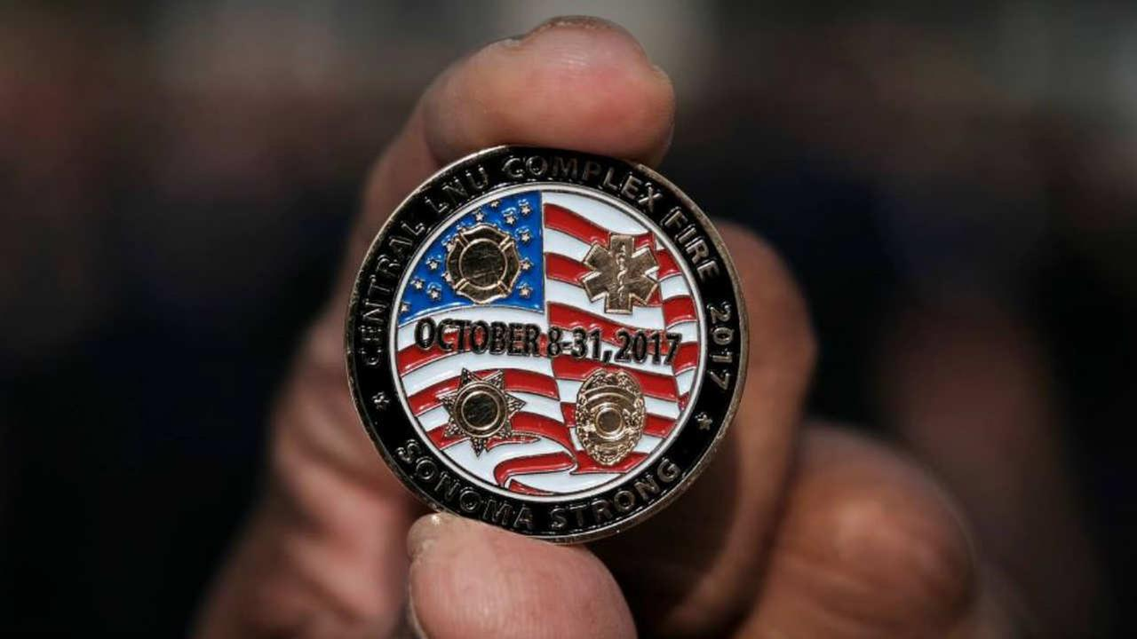 A pin honoring first responders of the North Bay Fires is seen in Santa Rosa, Calif. on Tuesday, Jan. 8, 2018.
