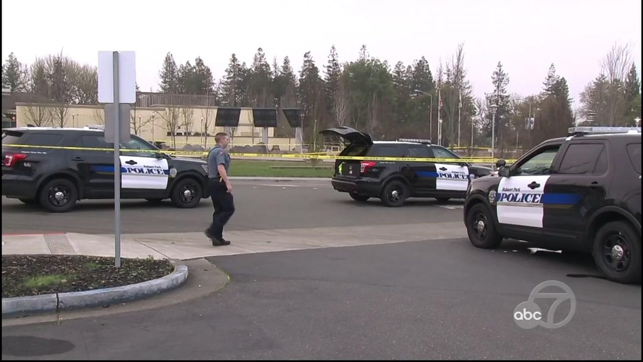 Police cars are seen after an officer shot an armed man following an hour-long confrontation in Rohnert Park, Calif. on Sunday, Jan. 14, 2018.