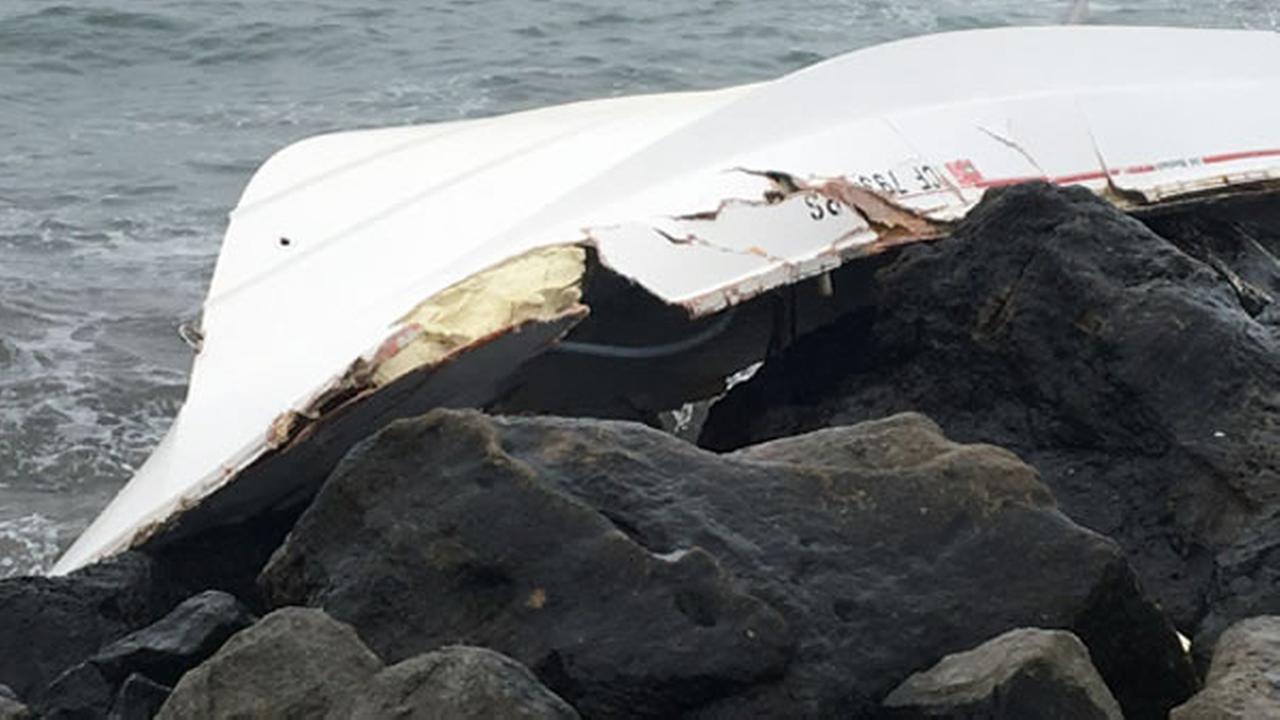 A boat overturned near Mavericks in Half Moon Bay, Calif. on Thursday, Jan. 18, 2018.