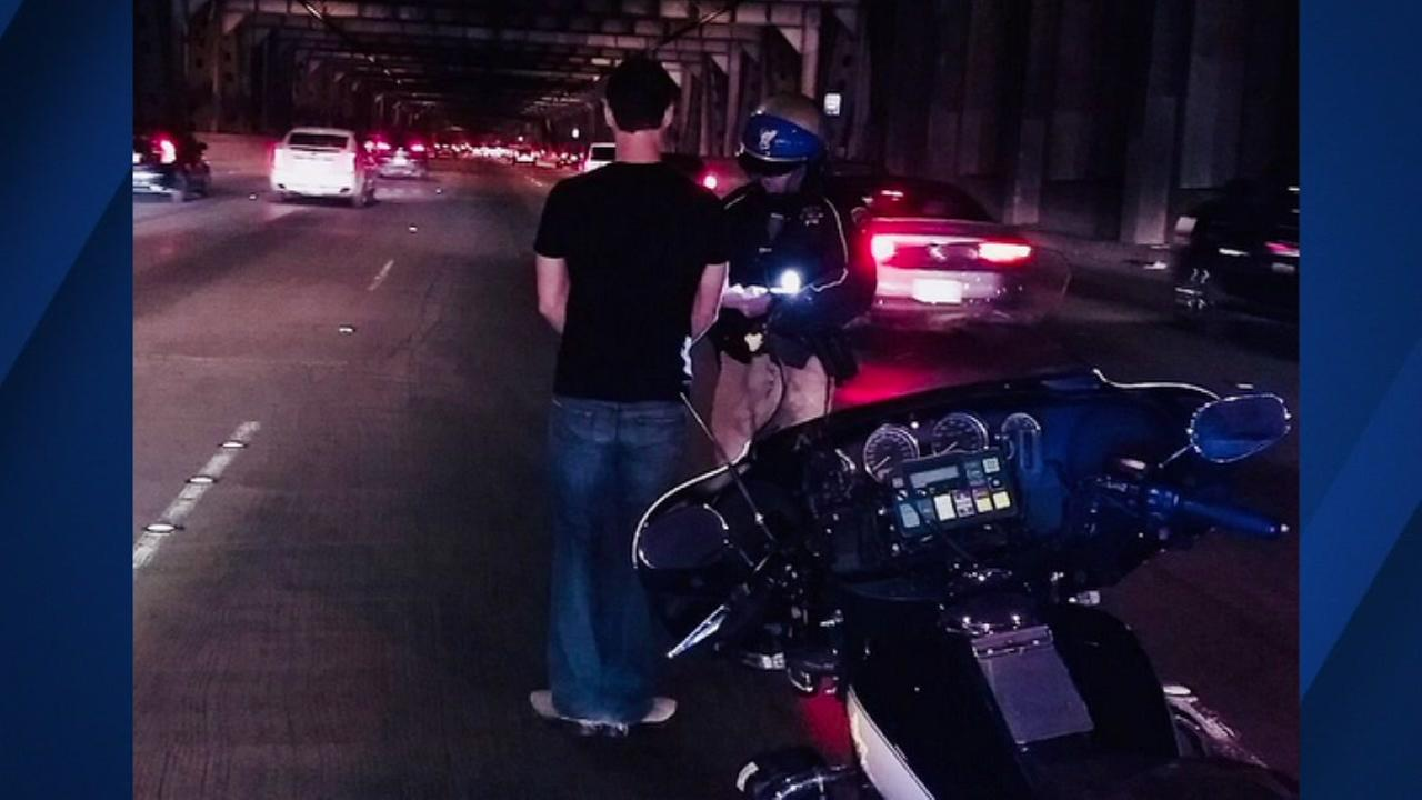 The California Highway Patrol tweeted a photo of a man found in his Tesla stalled on the Bay Bridge.