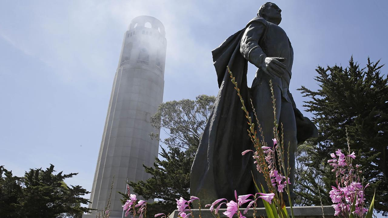 A statue of Christopher Columbus stands beneath Coit Tower Wednesday, May 14, 2014, in San Francisco.