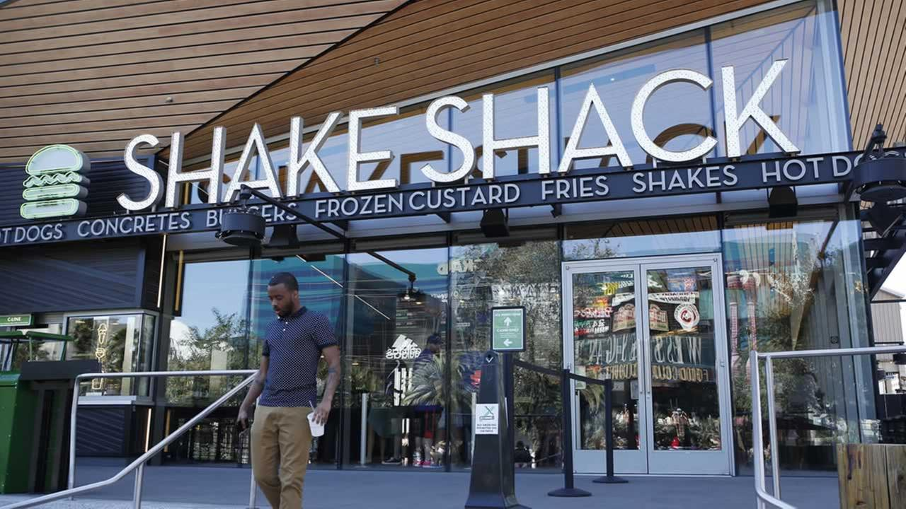 In this April 15, 2015, file photo, a man walks out of a Shake Shack in front of the New York-New York hotel and casino in Las Vegas.