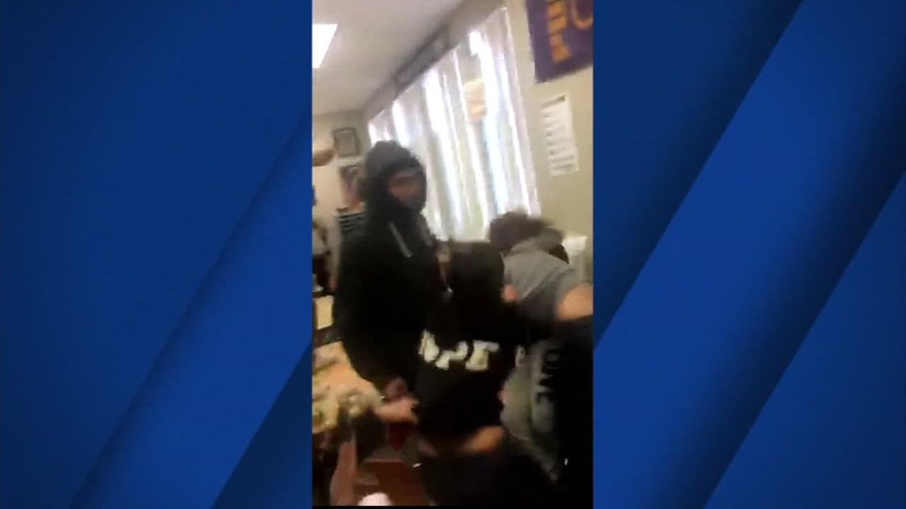 This still image shows a fight happening inside a classroom in Pittsburg, Calif.