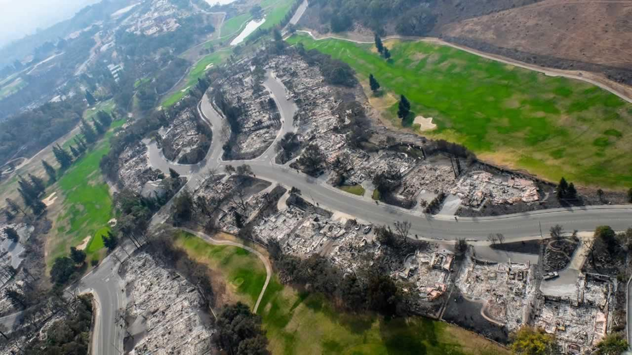 This aerial photo shows the view over a neighborhood destroyed by the wildfires in the North Bay.