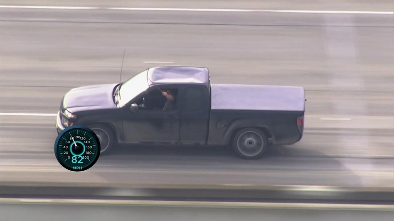 A man wielding a metal bar goes barrelling down a Bay Area highway on Monday, Jan. 29, 2018.