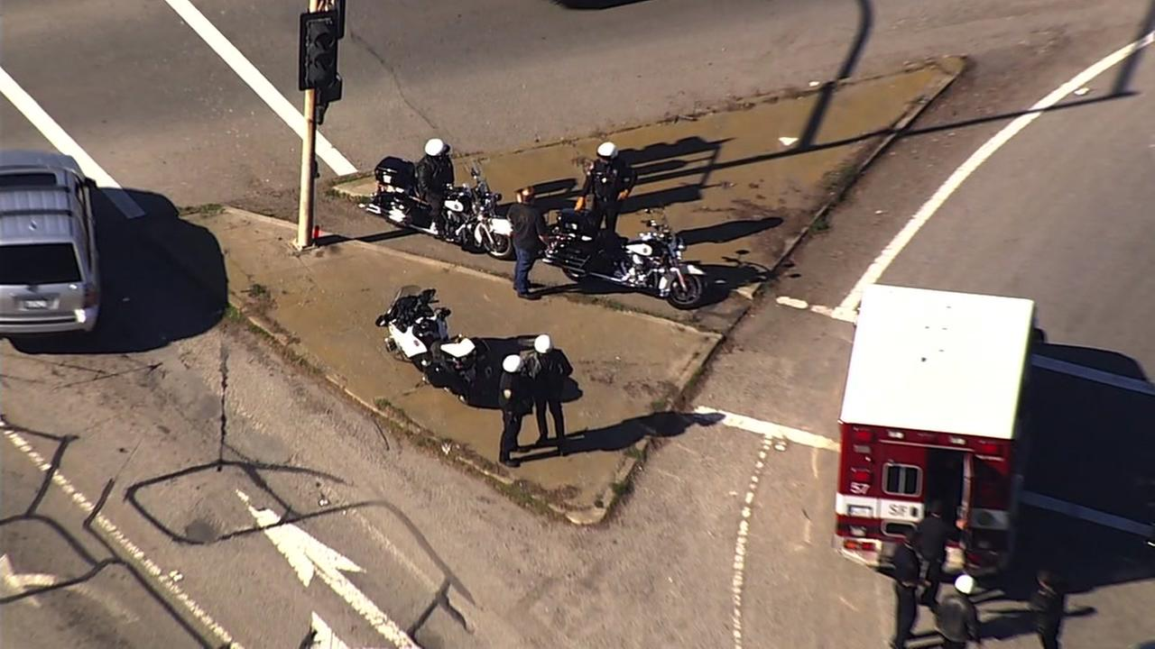 The scene of a crash involving a San Francisco police motorcycle officer is seen in Daly City, Calif. on Wednesday, Jan. 31, 2018.