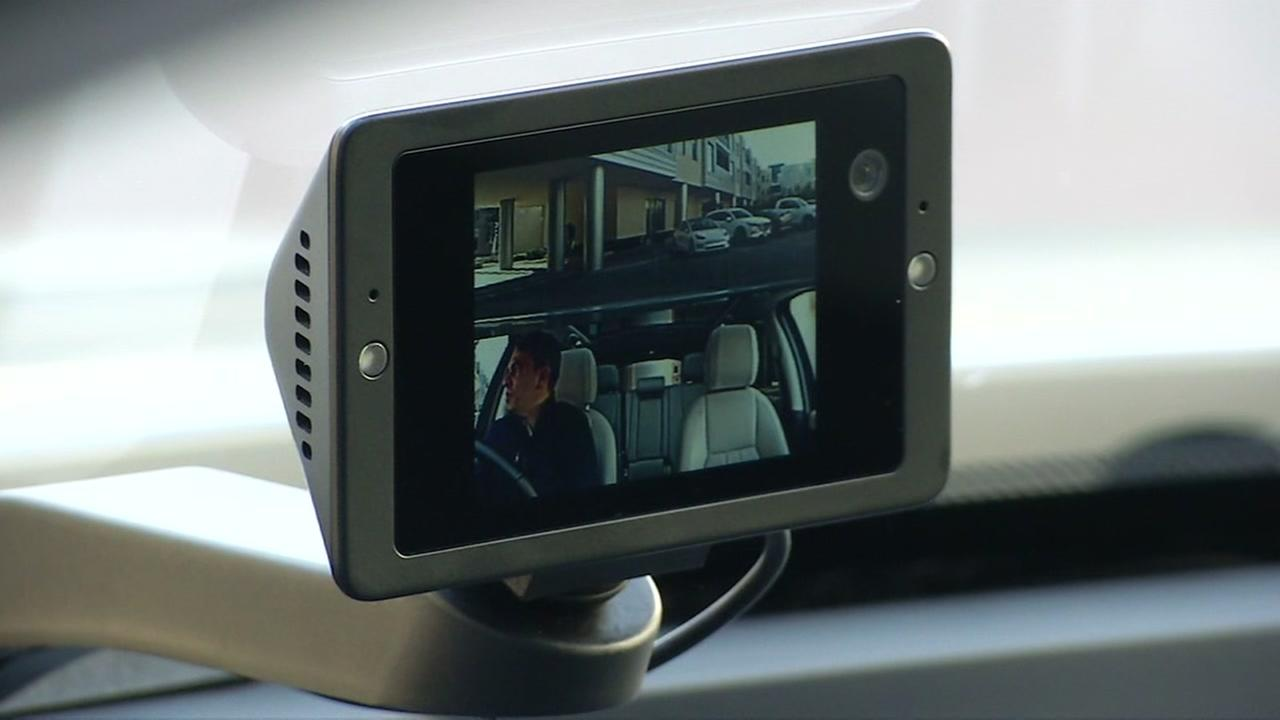 An Owl Camera is seen mounted on a cars dashboard in this undated image.