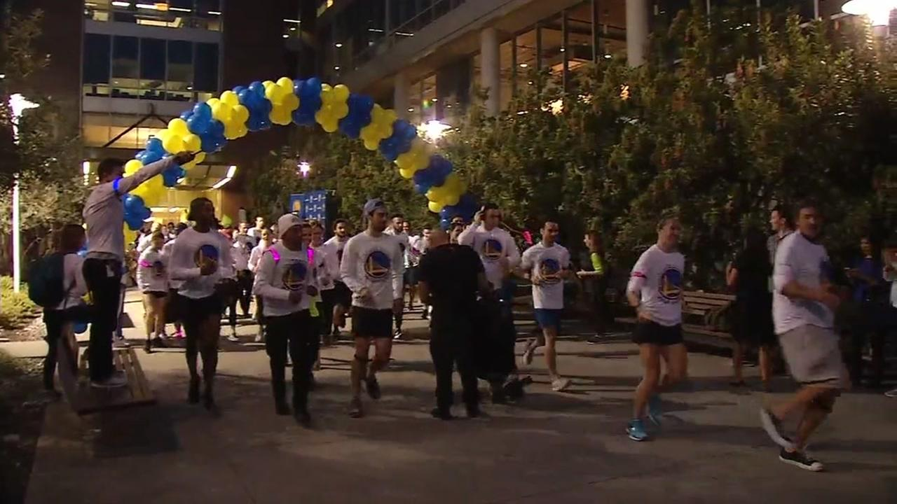 Runners take off at the first ever Warriors Run in San Francisco on Friday, Feb. 2, 2018.