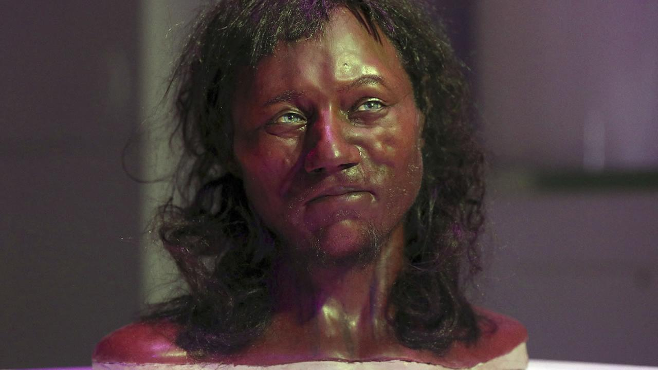 Full facial reconstruction model of a head based on the skull of Britains oldest complete skeleton on display during a screening event in London Wednesday Feb. 7, 2018. (AP Photo)