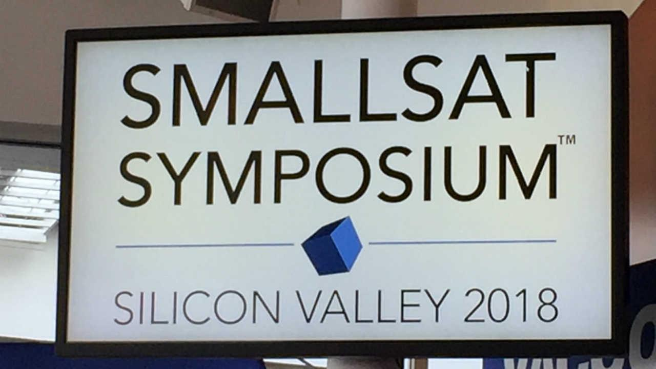 A sign for the SmallSat Symposium is seen in Mountain View, Calif. on Wednesday, Feb. 7, 2018.
