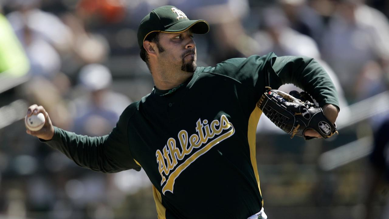 Oakland Athletics Esteban Loaiza pitches to the San Diego Padres in the first inning of a spring training baseball game in Phoenix, Ariz., Monday, March 19, 2007. (AP Photo/Jeff Chiu)