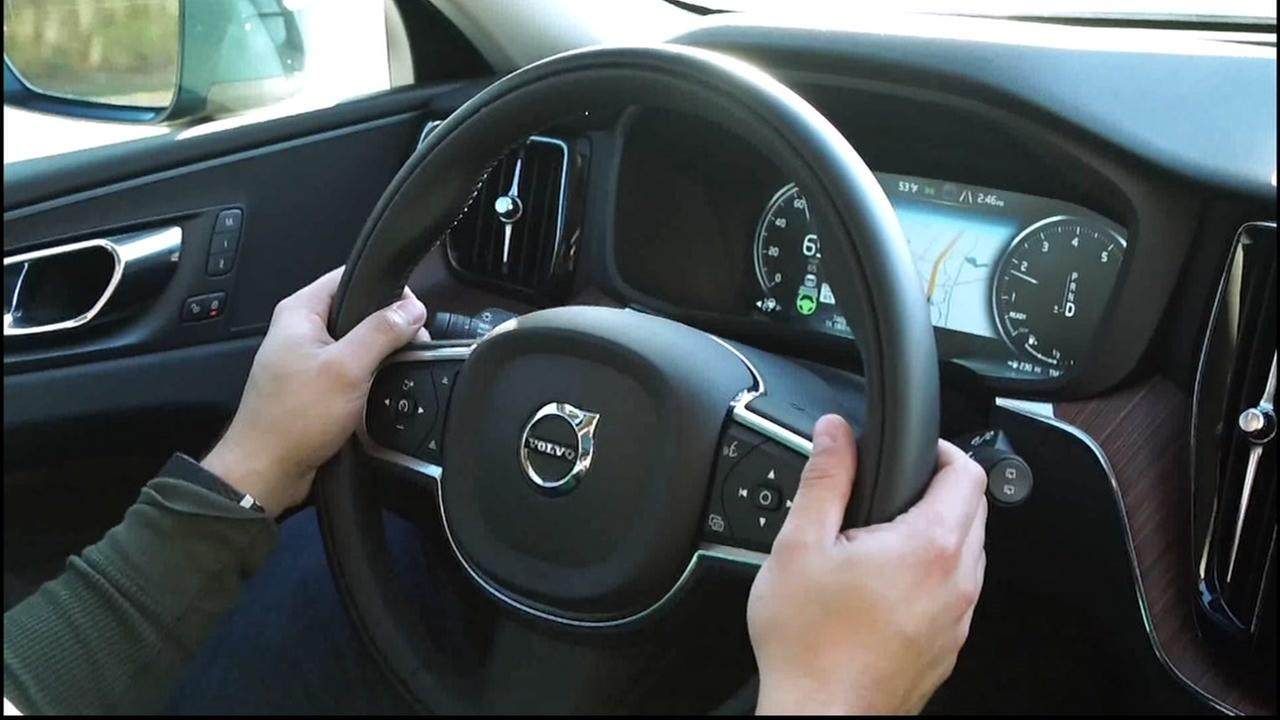A person sits behind the wheel of a Volvo in this undated file photo.