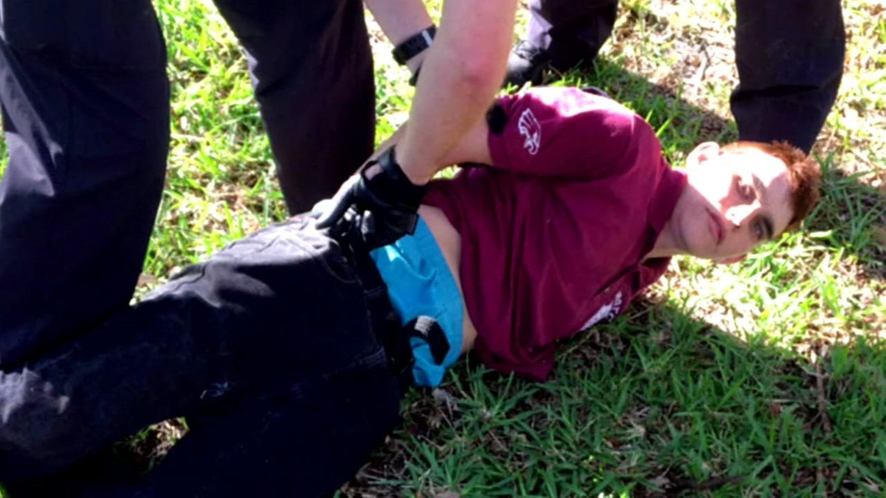 This image shows accused Florida school shooter, Nikolas Cruz, being apprehended in Parkland, Fla on Wednesday, Feb. 16, 2018.