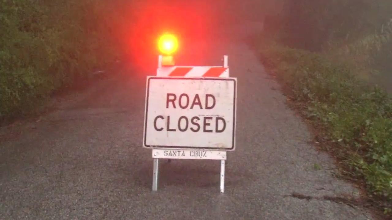 A sign shows that a Santa Cruz mountain road is closed.