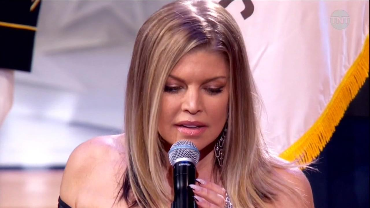 Fergie sings the national anthem at the NBA All-Star Game in Los Angeles on Sunday, Feb. 18, 2018.