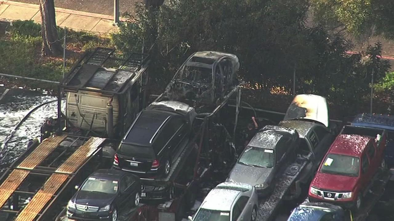 A truck carrying Mercedes-Benz cars caught fire and damaged several cars.