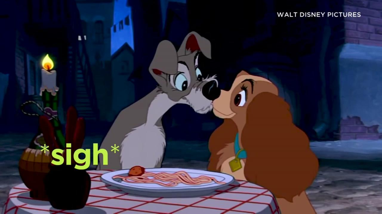 This still image is from the accidental spaghetti kiss between two beloved dogs in the 1955 film, Lady and the Tramp.