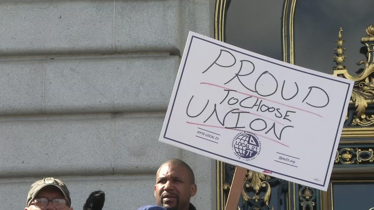 A protester holds a sign supporting unions in San Francisco on Monday, Feb. 26, 2018.