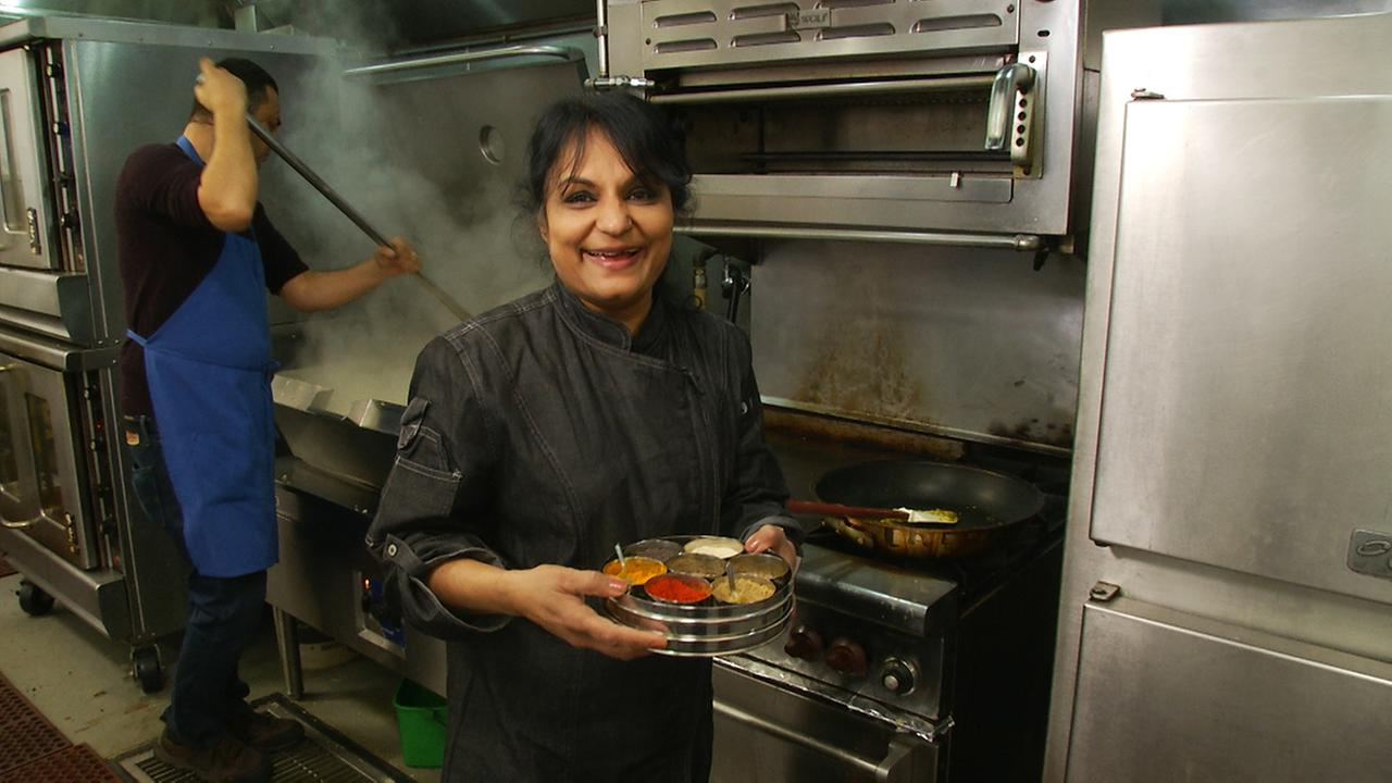 Chef Heena Patel, owner of Rasoi, prepares stuffed bread, one of the courses that will be featured during a special dinner she is preparing for International Womens Day.