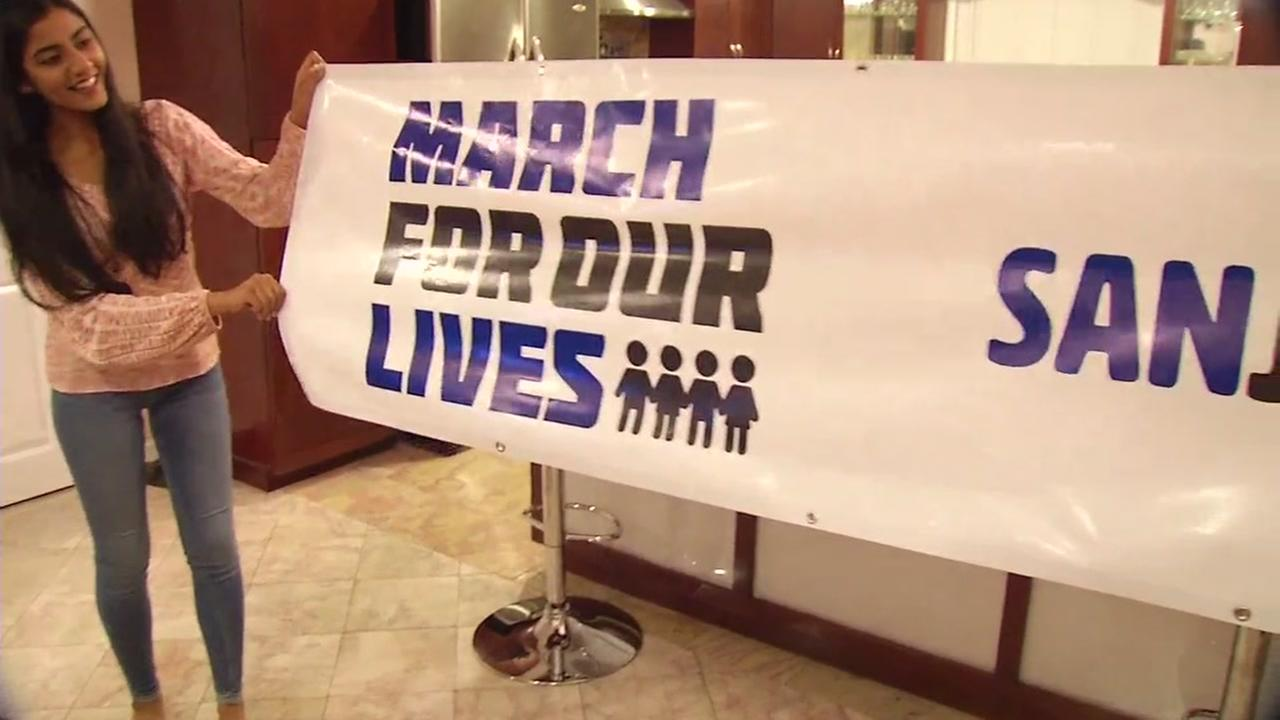 A San Jose student shows off the banner she and others will hold at the March For Our Lives San Jose event in San Jose, Calif. on Friday, March 2, 2018.