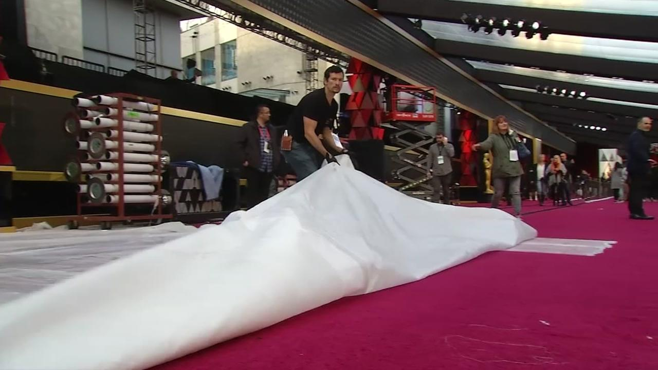 The plastic being lifted to reveal the red carpet is seen in Los Angeles, Calif. on Saturday, March 3, 2018.