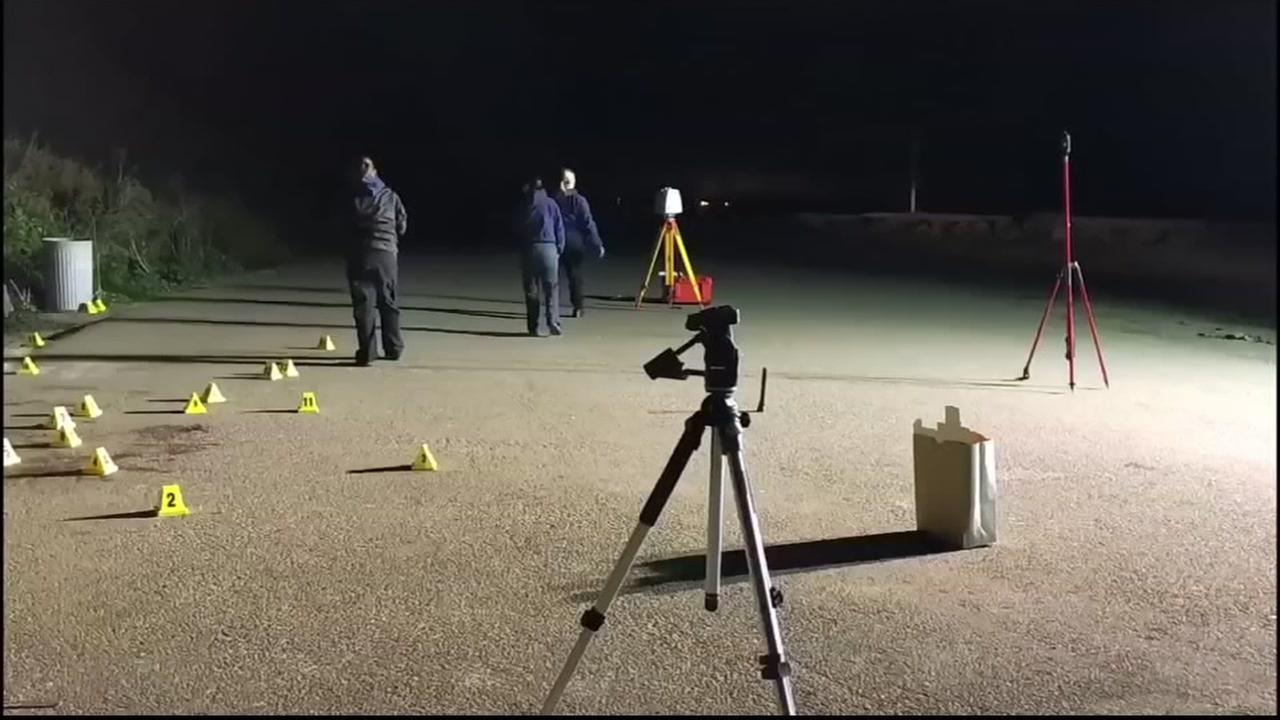 Evidence markers are seen in a parking lot near a beach in Montara, Calif. in this undated image.
