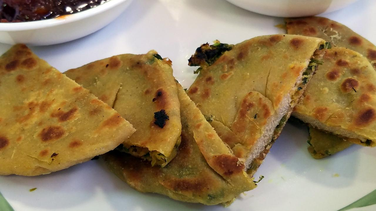 Kulchas are an Indian flat bread that is usually stuffed with potatoes, but Heena Patel who is the head chef at Rasoi, prepared a version with radishes. spring onions and cilantro.