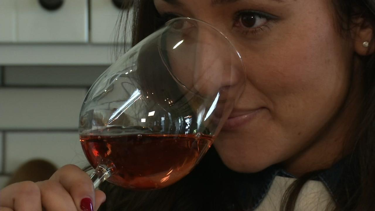 A woman is seen smelling a glass of wine in this undated image.