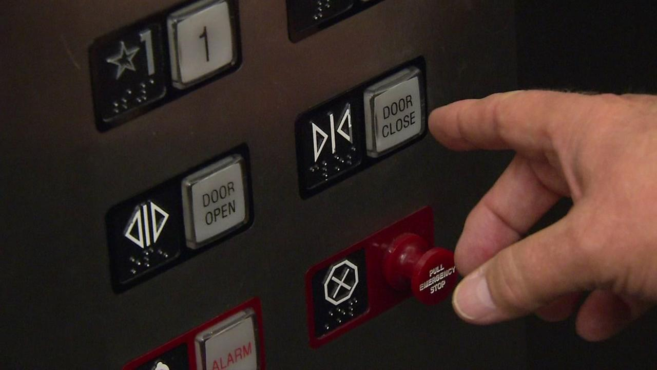 A person prepares to press the door close button in an elevator in San Francisco in this undated file photo.