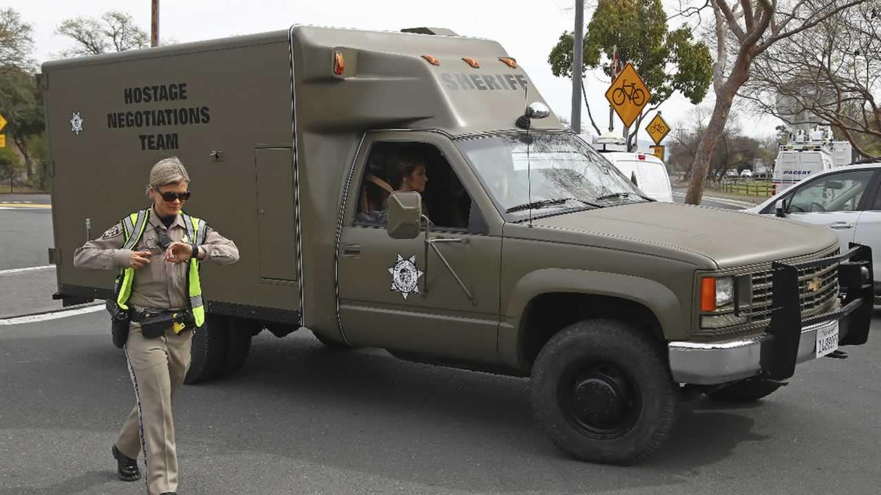 A sheriffs hostage negotiation team passes a California highway patrol checkpoint at the Veterans Home of California in Yountville, Calif., Friday, March 9, 2018.