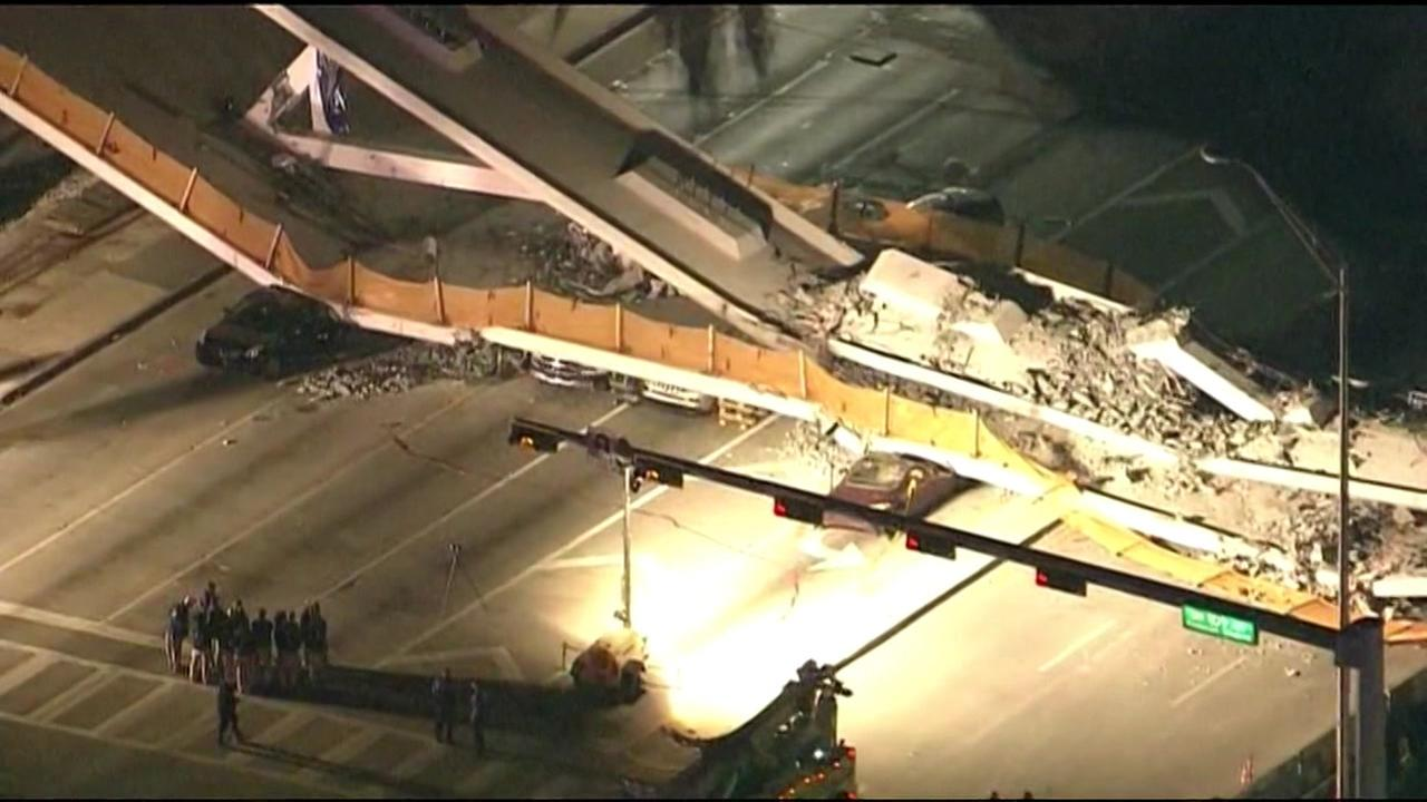 The collapsed bridge near FIU appears in Miami, Fla. on Thursday, March 15, 2018.