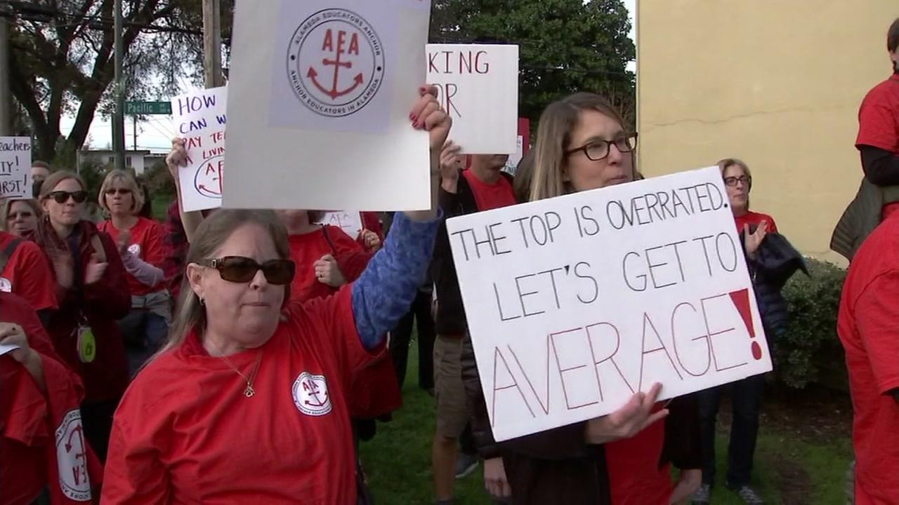 Alameda teachers march for more pay on Monday, March 19, 2018.