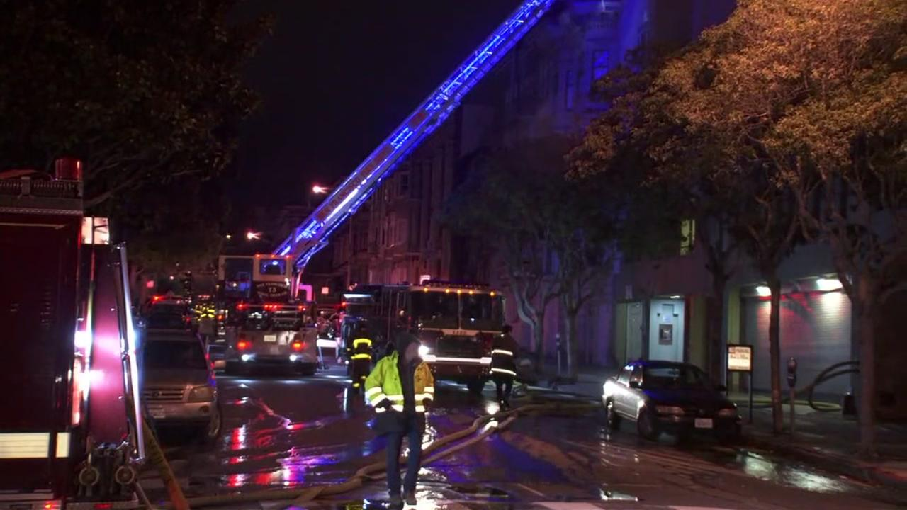 Firefighters at scene of two-alarm fire in San Francisco on Tuesday, March 20, 2018.