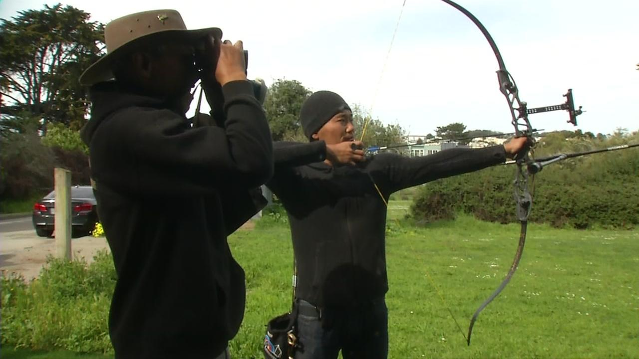 A person is seen shooting an arrow in San Francisco in this undated image.
