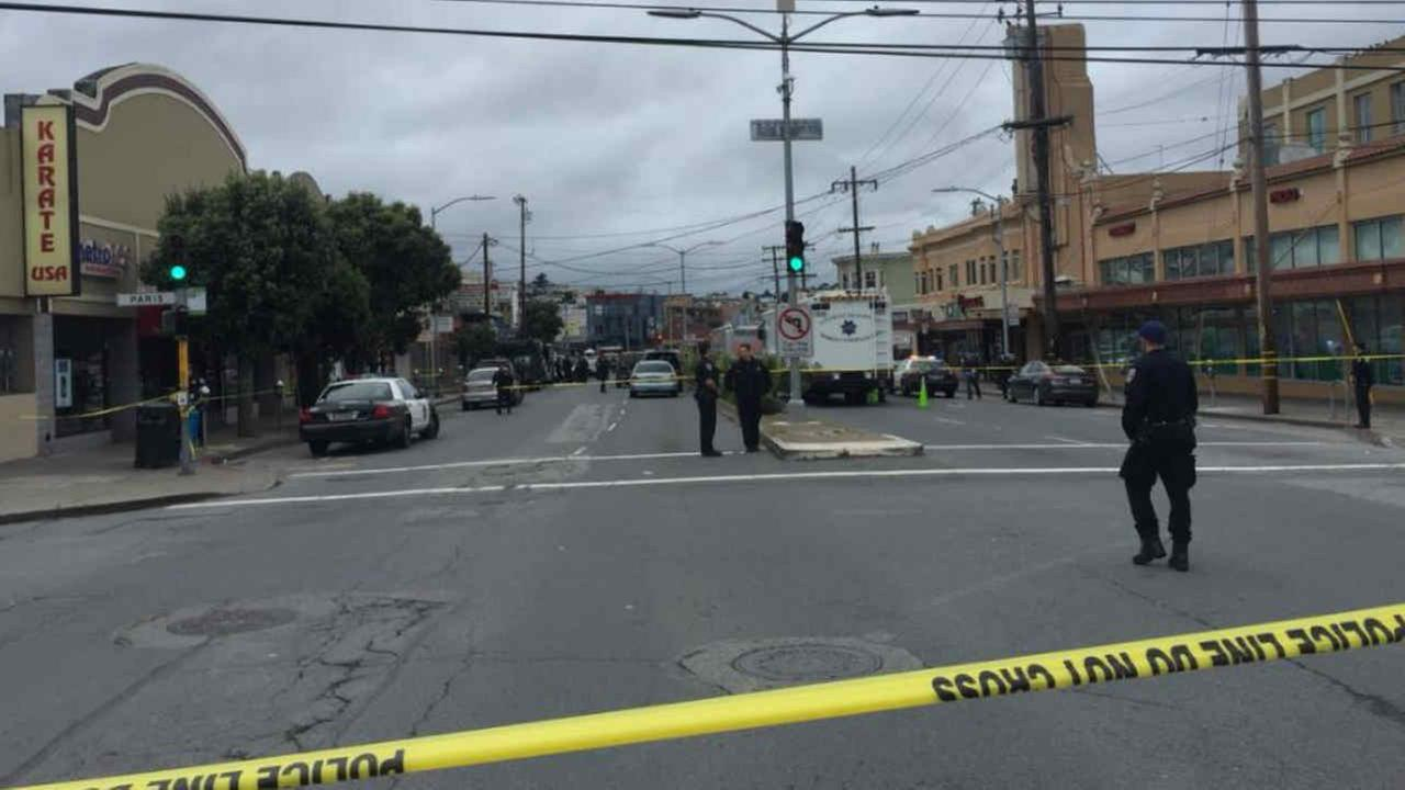 SFPD officers are seen after a fellow officer was shot in the leg near Geneva and Mission on Wednesday, March 21, 2018.