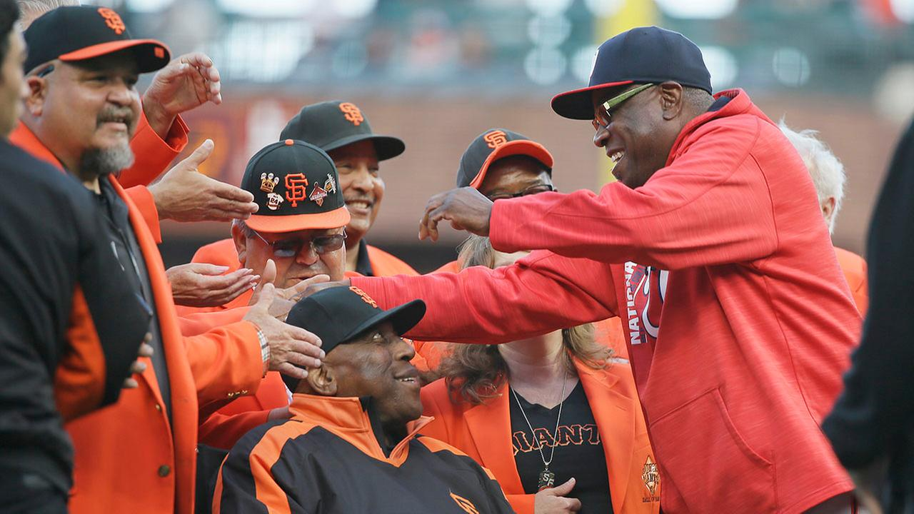 Dusty Baker, right, is greeted by Willie McCovey before the Nationals baseball game against the San Francisco Giants on Wednesday, May 31, 2017, in San Francisco.