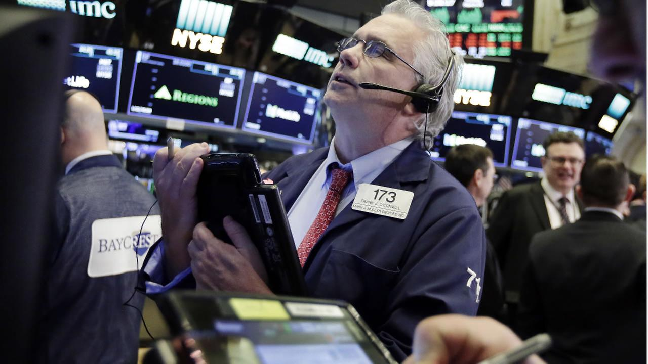 Trader Fran OConnell works on the floor of the New York Stock Exchange, Monday, March 26, 2018. (AP Photo/Richard Drew)