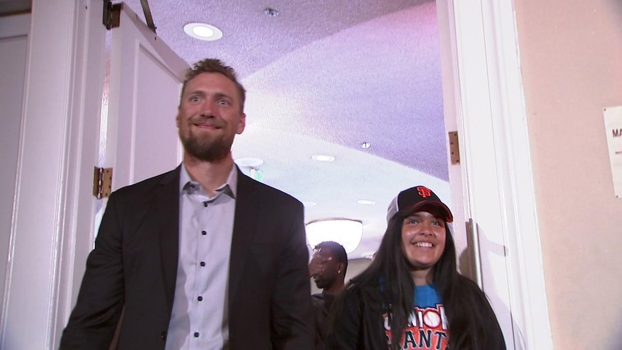 San Francisco Giants star Hunter Pence walks into the Play Ball luncheon with a Junior Giants player on Monday, March 26, 2018.