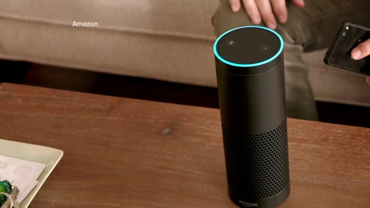 A person uses an Amazon Echo in this undated file photo.