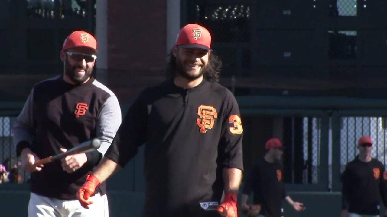San Francisco Giants shortstop Brandon Crawford is all smiles at AT&T Park as he warms up for the Bay Bridge Series on Monday, March 26, 2018.