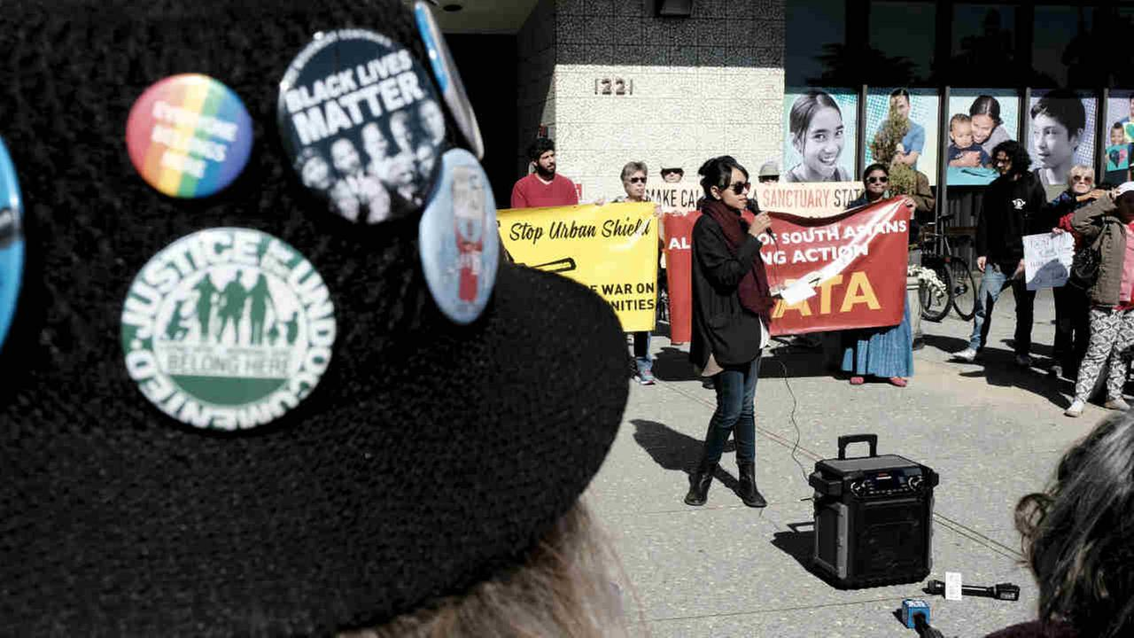 Protesters are seen outside an Alameda County Board of Supervisors meeting on Urban Shield funding on Tuesday, March 27, 2018.