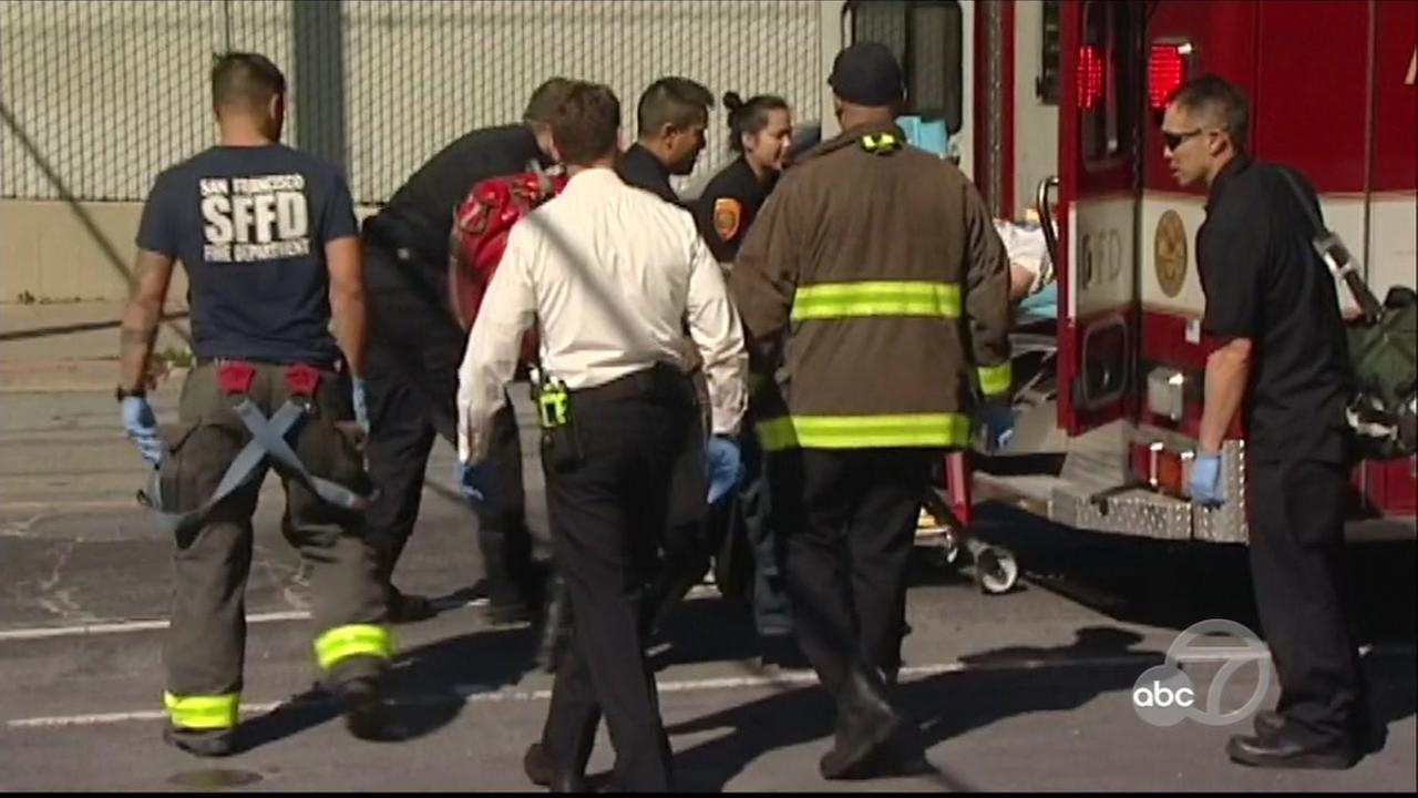Officials tend to victims of a San Francisco hit and run on Wednesday, March 28, 2018.