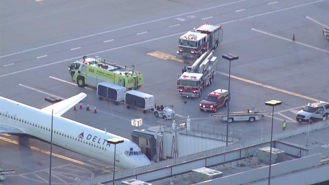 Ambulances and firetrucks tend to sick passengers at Mineta San Jose International Airport on Thursday, March 29, 2018.