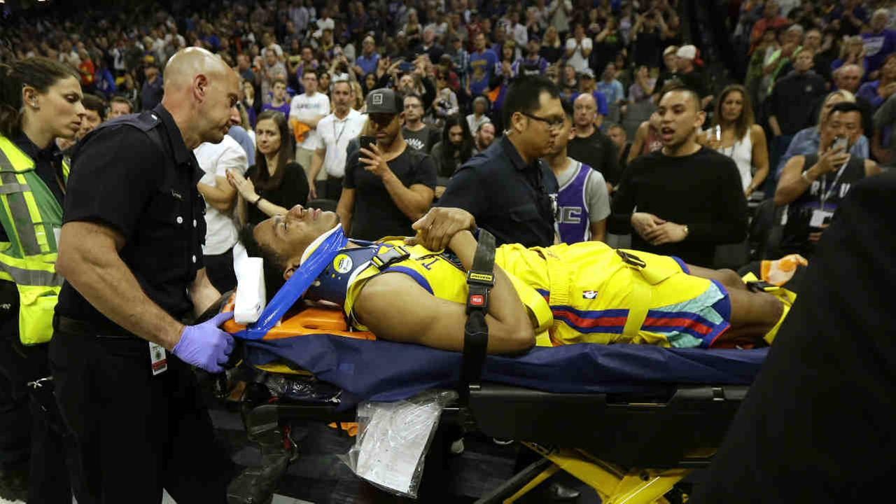 Golden State Warrior Patrick McCaw is taken off the court after falling following a foul by Sacramento Kingss Vince Carter Saturday, March 31, 2018, in Sacramento, Calif.