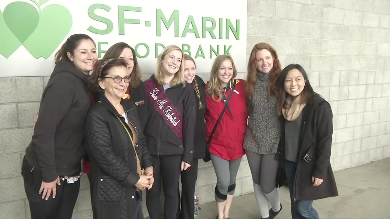 Bride-to-be Erin Jackson poses with her friends at SF-Marin Food Bank in San Francisco on Friday, April 6, 2018.