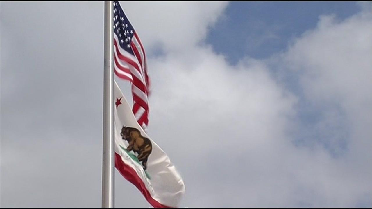 An American and California flag are pictured in this undated file photo.